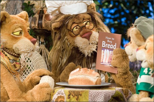 Theo reads a book to his family on PBS KIDS® series Between the Lions.<br /><br /><br /><br /><br /><br /> Credit: WGBH<br /><br /><br /><br /><br /><br />